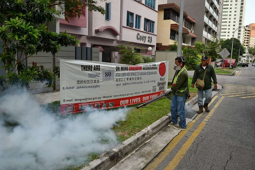 National Environment Agency contracted workers fogging against dengue mosquitoes at Lorong 30 Geylang in 2016.