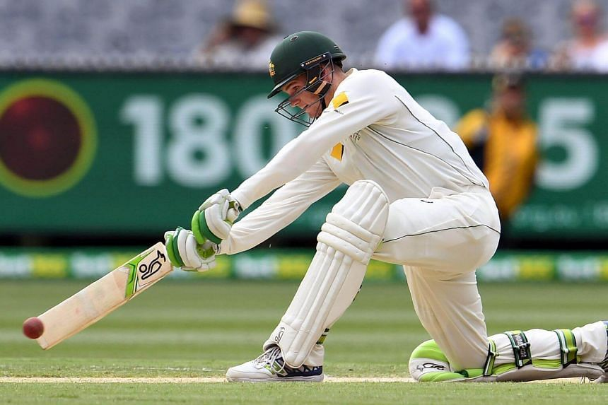 Australia's batsman Peter Handscomb sweeping a ball from the Pakistan bowling on the fourth day of the second cricket Test match in Melbourne.
