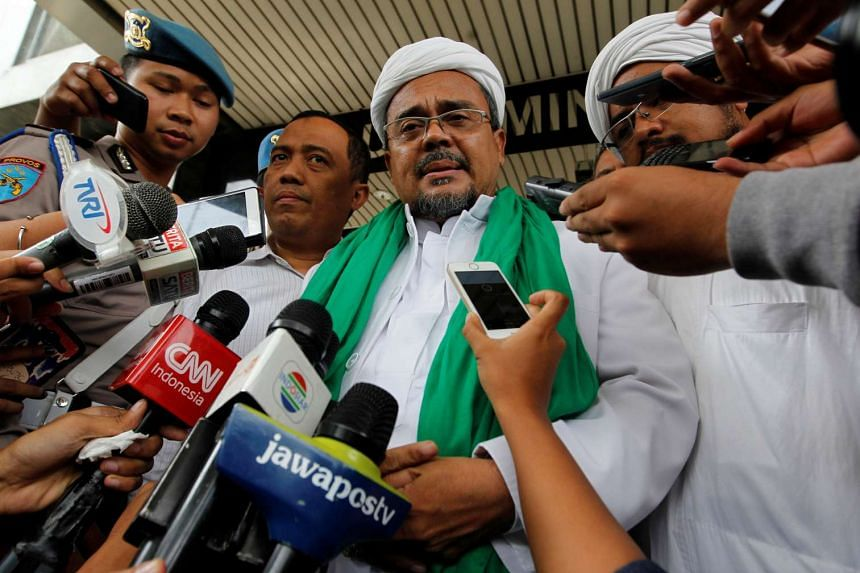 The hardline leader of the Islamic Defenders Front, Habib Rizieq, remains under police probe for allegedly insulting the national doctrine.