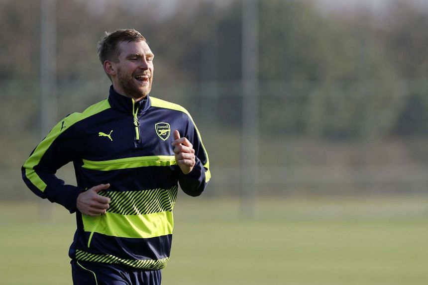 Arsenal have triggered an option to extend Per Mertesacker's contract.