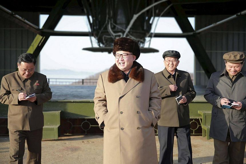 North Korea leader Kim Jong Un smiles as he visits Sohae Space Center in Cholsan County, North Pyongan province for the testing of a new engine for an intercontinental ballistic missile (ICBM).