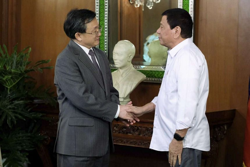 Philippine President Rodrigo Duterte (right) shaking hands with Chinese Vice-Foreign Minister Liu Zhenmin at the Malacanang Presidential Palace in Manila on Jan 17, 2017.