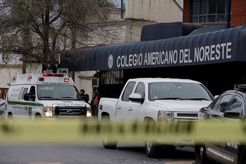 A yellow police line cordons off access to the Colegio Americano del Noreste after a student opened fire at the American school, according to the state's security spokesman, in Monterrey, Mexico on Jan 18, 2017.