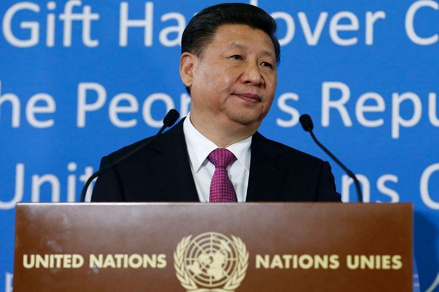 Chinese President Xi Jinping addresses guests during a gift handover ceremony at the United Nations European headquarters in Geneva on Jan 18, 2017.