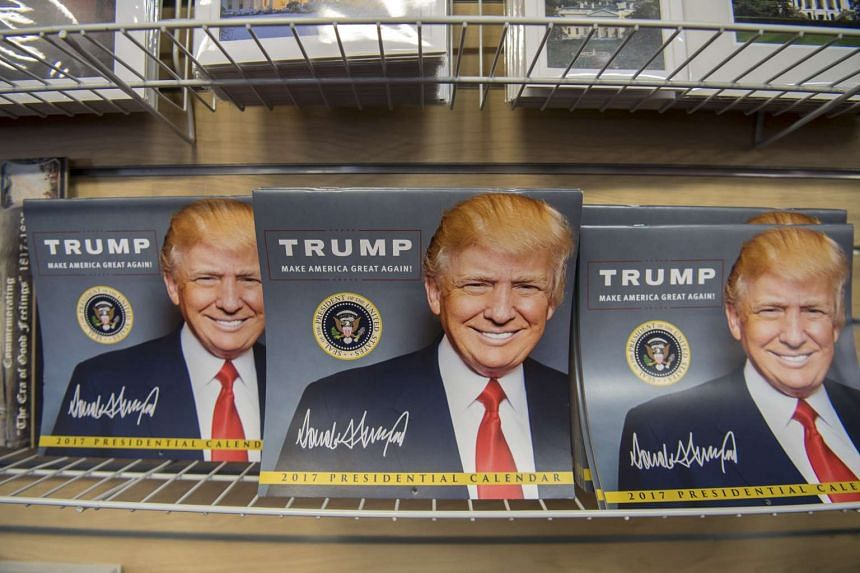 US President-elect Donald Trump presidential inauguration memorabilia is displayed for sale in the White House gift store in Washington, DC, on Jan 18, 2017.