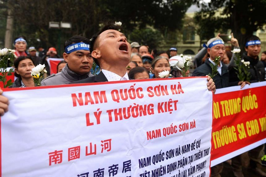 An activist shouting anti-China slogans during a demonstration in Hanoi on Jan 19, 2017.