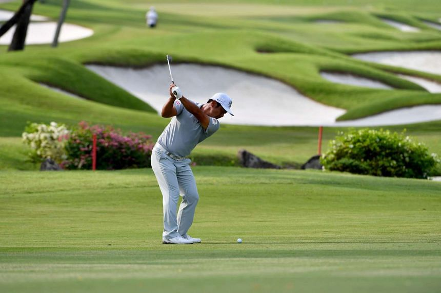 Hideto Tanihara of Japan teeing off during round one of the SMBC Singapore Open at the Sentosa Golf Club.