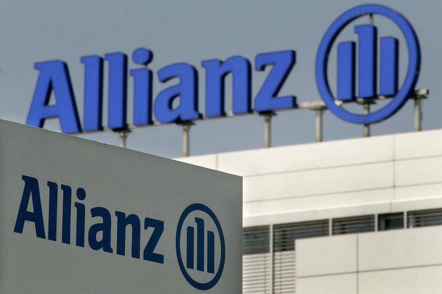 Allianz logos are pictured in front of the headquarters of German insurance group Allianz AG in Munich, Germany.