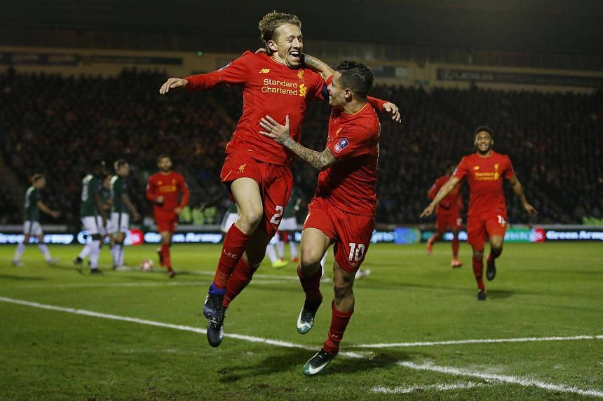 Liverpool's Lucas Leiva (left) celebrates scoring their first goal with Philippe Coutinho.