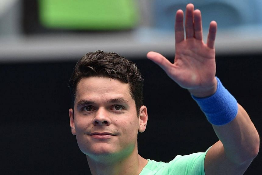 Milos Raonic of Canada celebrates his victory over Dustin Brown of Germany in their men's singles match on day two of the Australian Open tennis tournament in Melbourne on Jan 17, 2017.