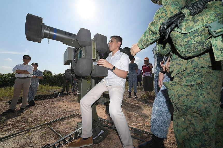 Senior Minister of State for Defence Mohamad Maliki Osman gets a feel of the RBS-70 missile system. Dr Maliki visited the Safti Live Firing Area yesterday, where RSAF's Ground-Based Air Defence units were competing against each other in the annual Fl