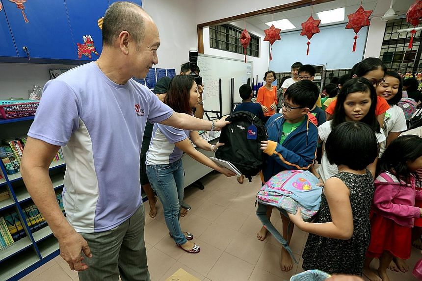 CEO Wee Ee Cheong joined other UOB senior management, staff and clients in giving out school bags to children in Bukit Batok yesterday.