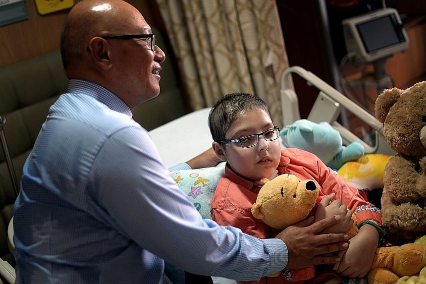Shayan and Dr Goh at Mount Elizabeth Hospital yesterday. Since arriving deathly ill on Oct 13, the 10-year-old has made a miraculous recovery with the help of his doctor and crowdfunding efforts by a group of individuals here who found out about his