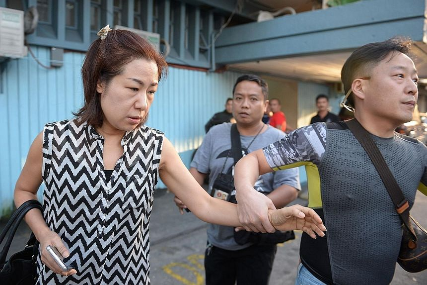 Mr Jee vanished from his home in the northern city of Angeles last October. Ms Choi, the wife of Mr Jee, being escorted by a friend at the National Bureau of Investigation headquarters in Manila yesterday. The authorities say Philippine police kidnap