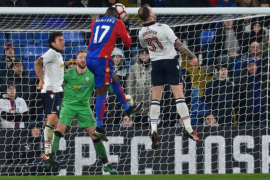 Crystal Palace striker Christian Benteke heading their equaliser in the 66th minute of their FA Cup third-round replay against Bolton at Selhurst Park. The substitute scored again in the 77th minute to complete a 2-1 comeback victory.