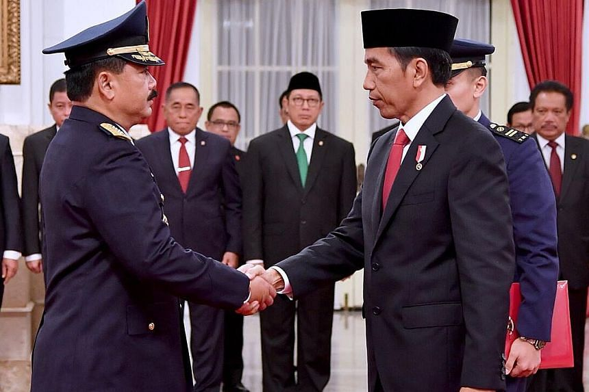 Air Marshal Hadi (left) and President Joko are said to have developed a close friendship when they were both based in Solo.