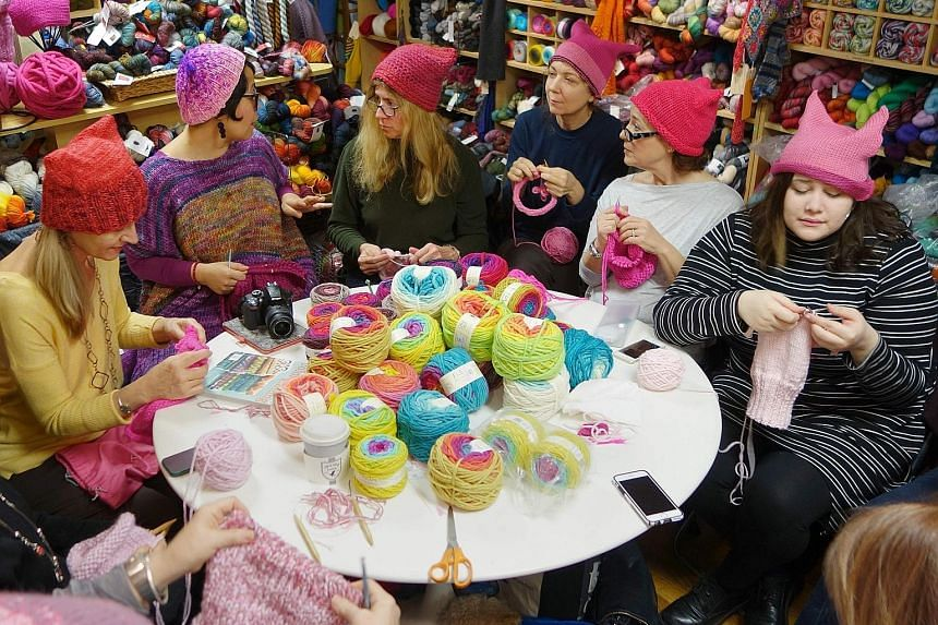 Members of the Pussyhat Project knitting hats for protesters to wear at planned marches for women's rights in Washington and New York on Saturday, the day after Mr Trump's inauguration. Around 60 Democratic Party lawmakers have also said they will bo
