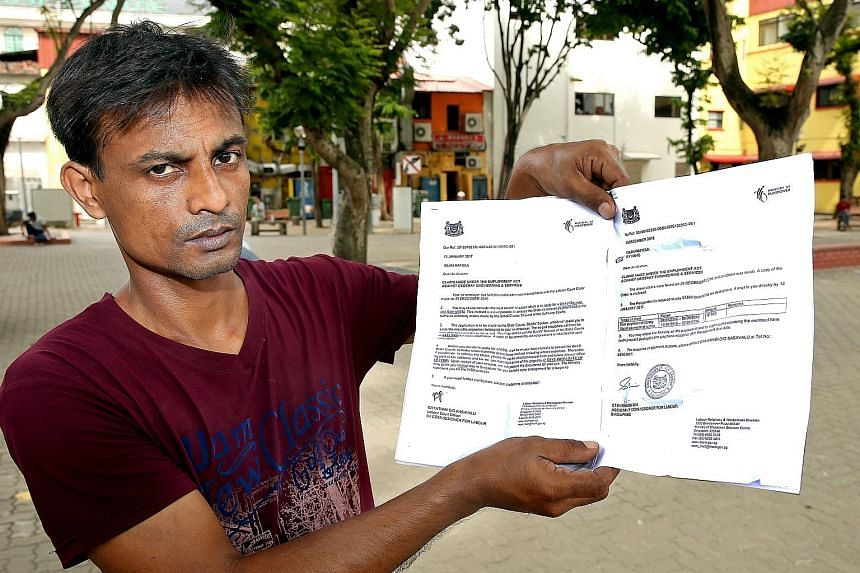 Mr Islam holding up the MOM letter directing him to the State Courts to recover the $7,363 his employer owed him after the boss missed the Labour Court's deadline. The legal action would cost him more than $1,000.