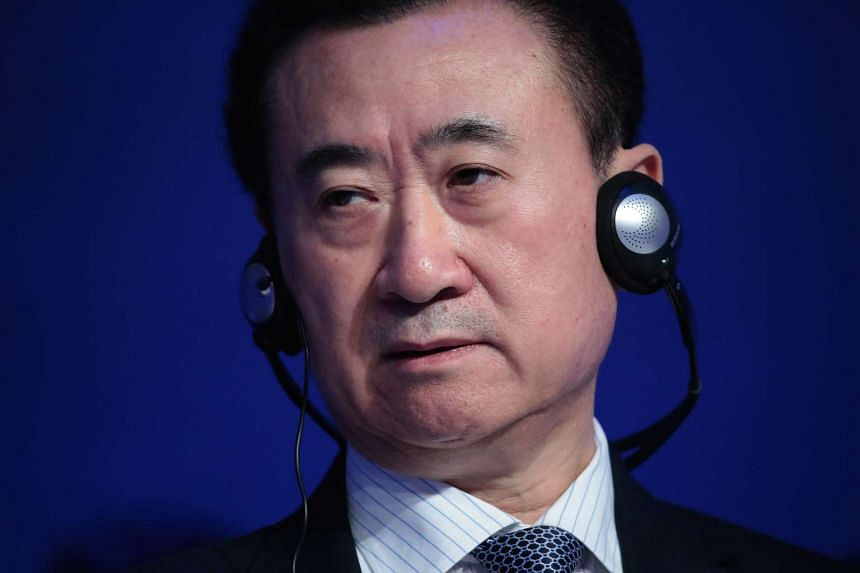 Chinese billionaire Wang Jianlin listening during a panel session at the World Economic Forum in Davos on Jan 18, 2017.