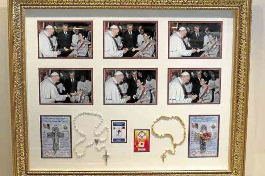 A display of memorabilia at one of chef Jessie Sincioco's restaurants, showing Pope Francis during his visit to the Philippines in 2015.