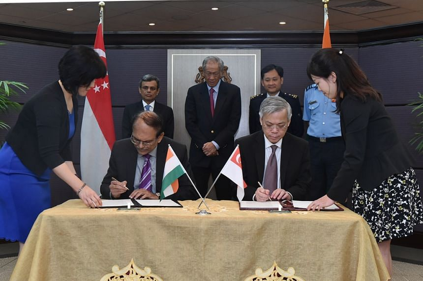 India's Defence Secretary G Mohan Kumar (seated, left) and Permanent Secretary (Defence) Chan Yeng Kit (seated, right) sign the renewal of the Bilateral Agreement for the Conduct of Joint Military Training and Exercises in India, while India's Hi