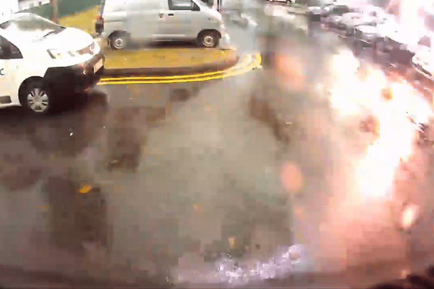 A screengrab of the video delivery driver Fahrol Razi posted on Facebook, showing a lightning strike a tree at the carpark.