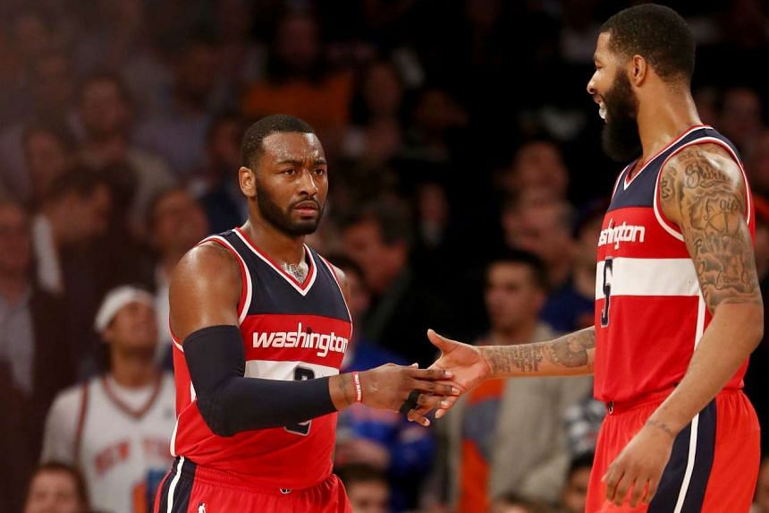 John Wall (left) and Markieff Morris celebrate the win over the New York Knicks at Madison Square Garden on Jan 19, 2017.