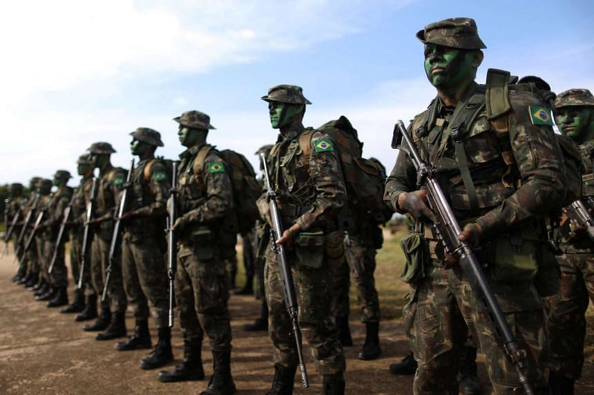 Brazilian Army soldiers at the border with Colombia during a training to show efforts to step up security along borders, in Vila Bittencourt, Amazon State, Brazil on Jan 18, 2017.