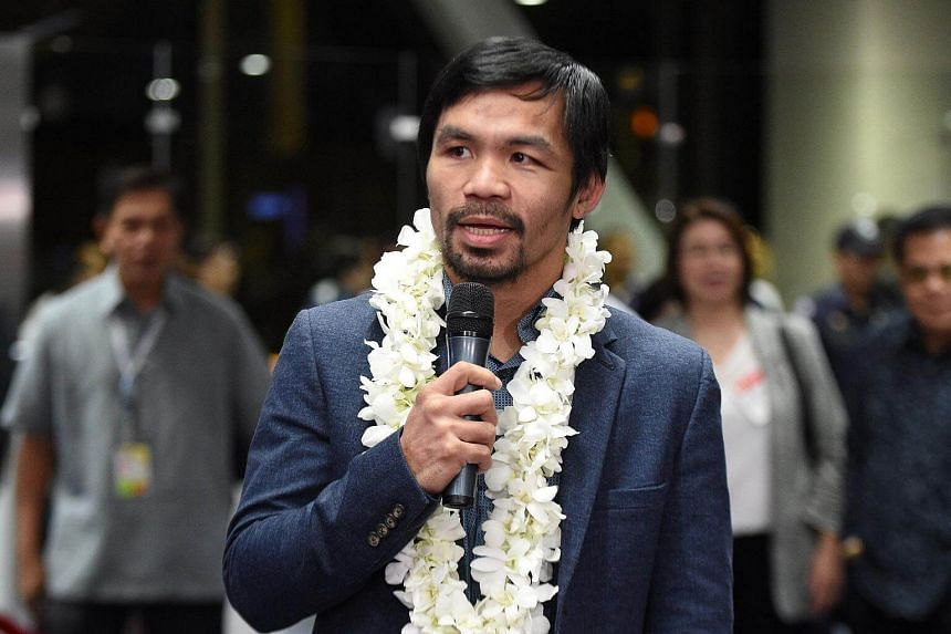 Philippine boxing icon Manny Pacquiao talking to members of the media, shortly after arriving from the US at Manila airport on Nov 8, 2016.