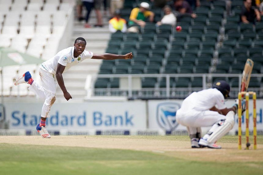 South Africa's Kagiso Rabada bowls a short ball to Sri Lanka's Dhananjaya De Silva.