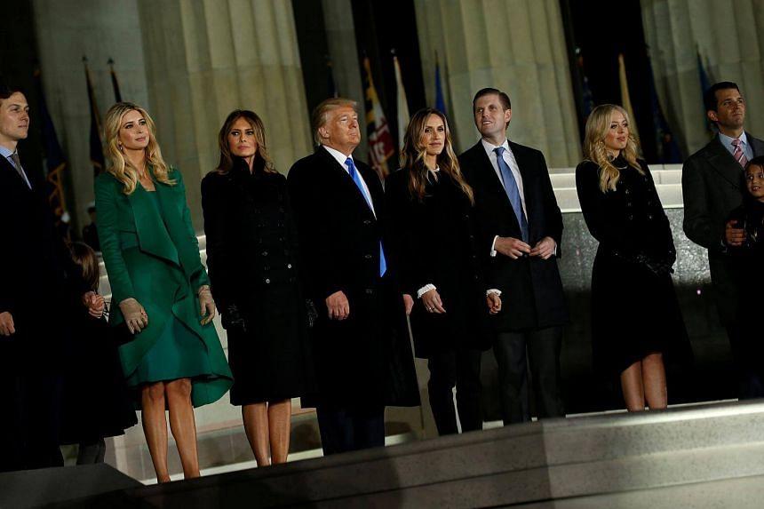 US President-elect Donald Trump and his family take part in a Make America Great Again welcome concert in Washington, DC.
