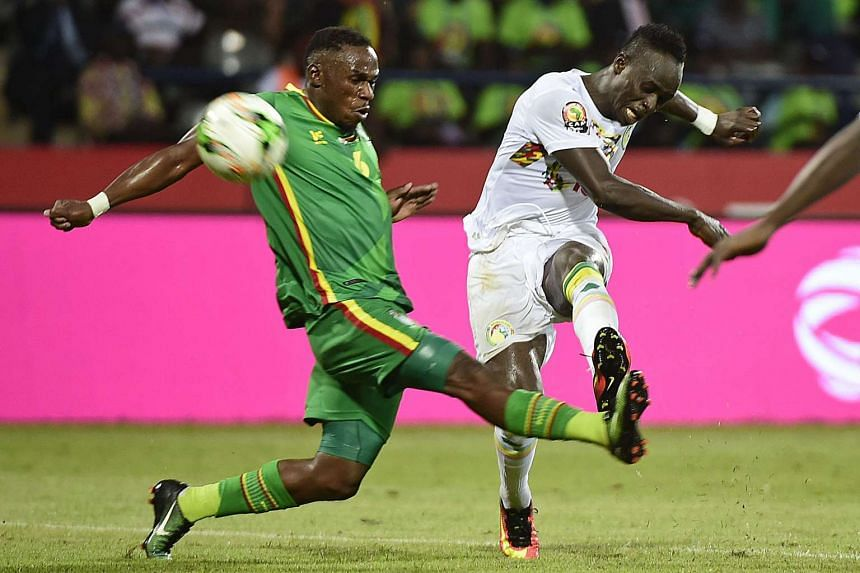 Senegal's forward Sadio Mane kicking the ball past Zimbabwe's defender Onismor Bhasera during the 2017 Africa Cup of Nations group B football match between Senegal and Zimbabwe on Jan 19, 2017.