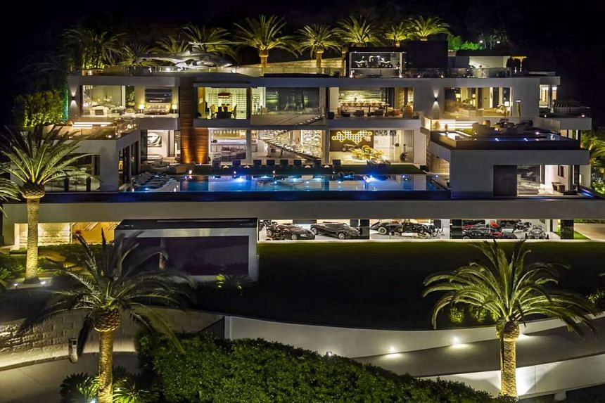 The sprawling 38,000 sq ft home has 12 bedrooms, 21 bathrooms, three kitchens and five bars.