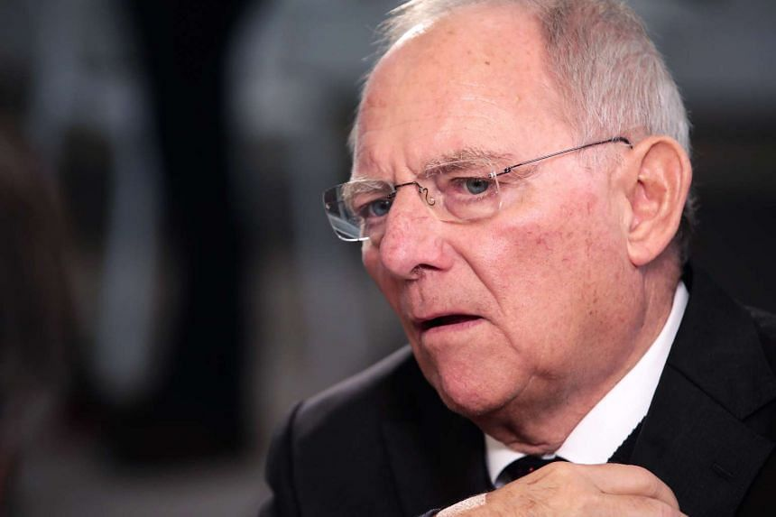 German Finance Minister Wolfgang Schaeuble said the United States must stick to international agreements under the presidency of Donald Trump.