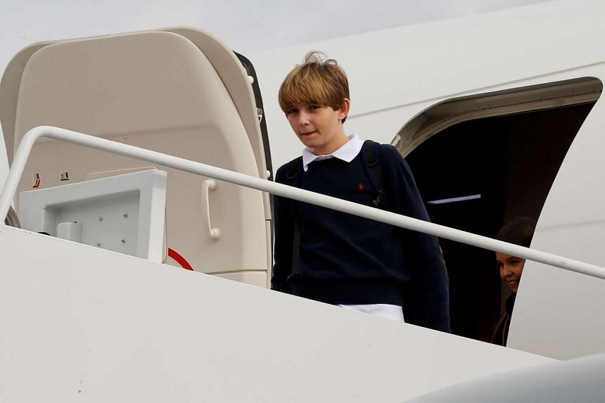 Mr Trump's 10-year-old son Barron arrives with him on a US Air Force jet in Maryland on Thursday.