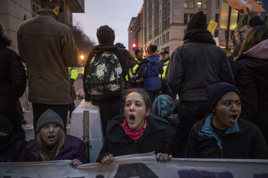 Protesters attempting to block an entrance to the National Mall as they rally against the inauguration of Donald Trump.