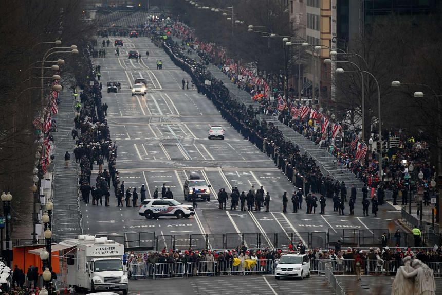 Police vehicles sit on a road ahead of the 58th presidential inauguration in Washington, Jan 20, 2017.