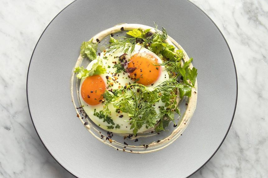 The faina and fried eggs, one of the new dishes from Argentinian restaurant Bochinche.