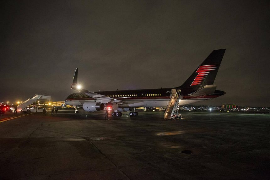 President-elect Donald Trump boards his personal plane to fly to Washington for an event ahead of his inauguration at LaGuardia Airport in New York.