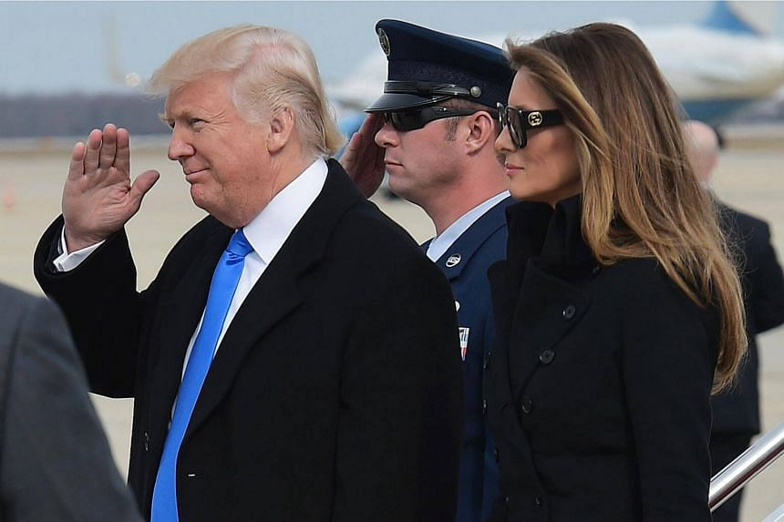 US President-elect Donald Trump and wife Melania Trump step off a plane upon arrival at Andrews Air Force Base in Maryland.