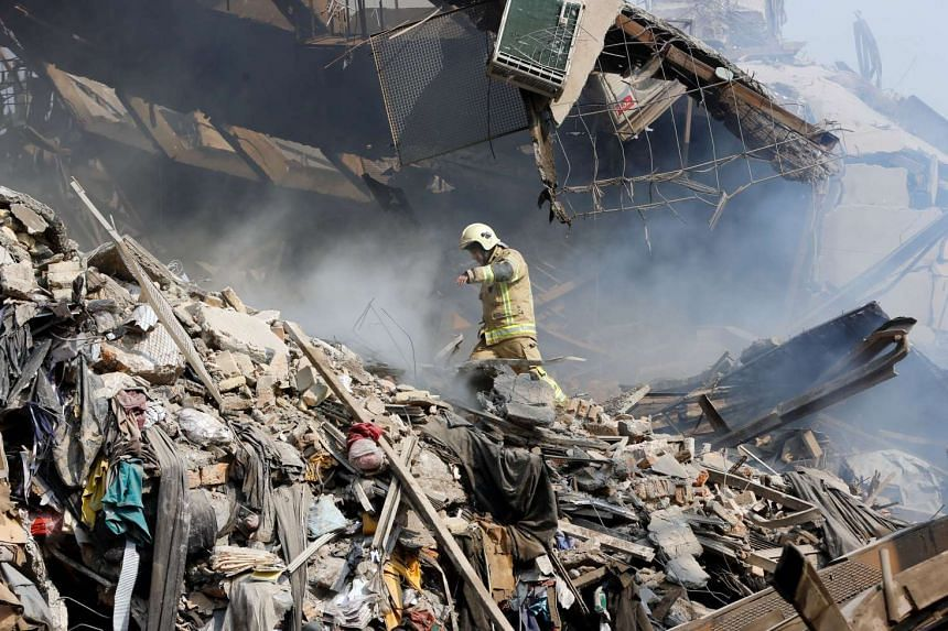 The Plasco building, which was Iran's oldest high-rise and contained a shopping centre and hundreds of clothing suppliers, came down after a four-hour blaze.