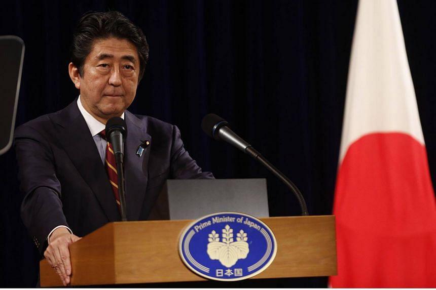 Japan's Prime Minister Shinzo Abe speaks at a press conference in Hanoi on Jan 16, 2017.