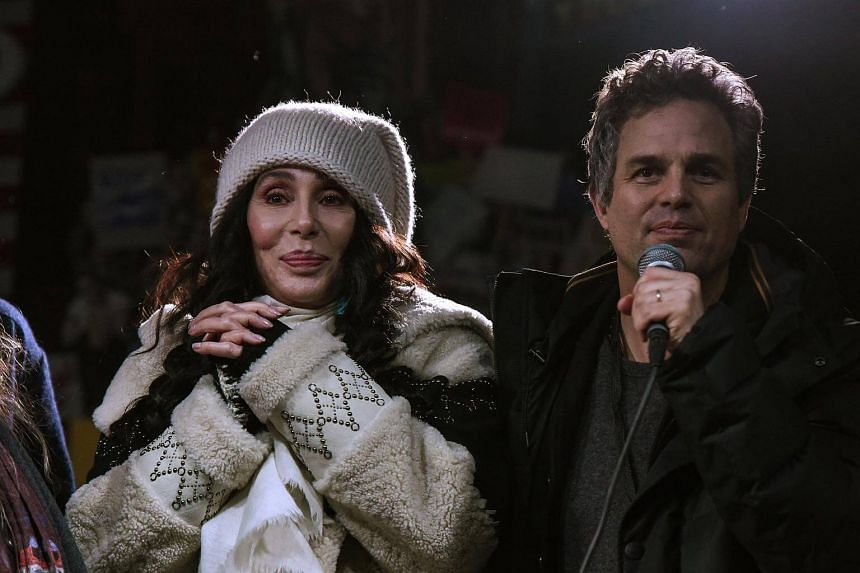 Singer Cher and actor Mark Ruffalo share the stage at a protest against US President-elect Donald Trump outside the Trump International Hotel in New York City on Jan 19, 2017.