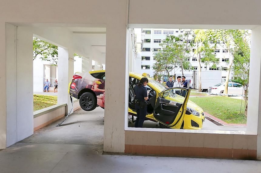 The taxi mounted a kerb and shot up a low wall before getting wedged in the middle of a sheltered walkway in Jurong West Street 81. No injuries were reported, according to the Singapore Civil Defence Force.