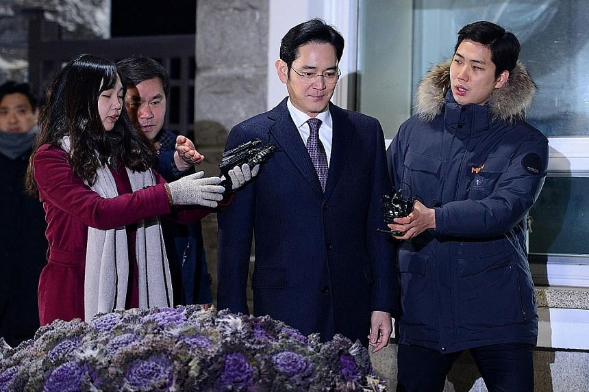 Mr Lee leaving the Seoul Detention Centre yesterday. The court says there is a lack of evidence to justify his arrest at the current stage of investigations.