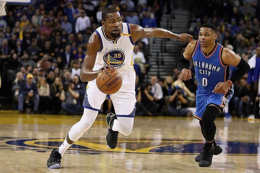 Warriors forward Kevin Durant dribbles past former team-mate and Thunder star Russell Westbrook at Oracle Arena. Durant had a season-best 40 points on Wednesday.