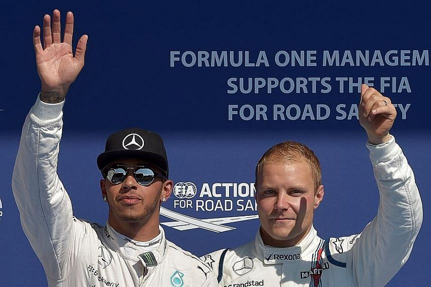Mercedes driver Lewis Hamilton (left) and Valtteri Bottas at the Belgian Grand Prix last season, when Bottas was racing with Williams. The duo will be team-mates in the new campaign.