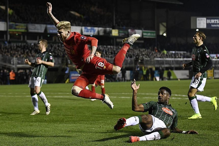Plymouth defender Yann Songo'o fouls Liverpool's Alberto Moreno in the box. The resulting penalty, taken by forward Divock Origi, was saved by goalkeeper Luke McCormick.