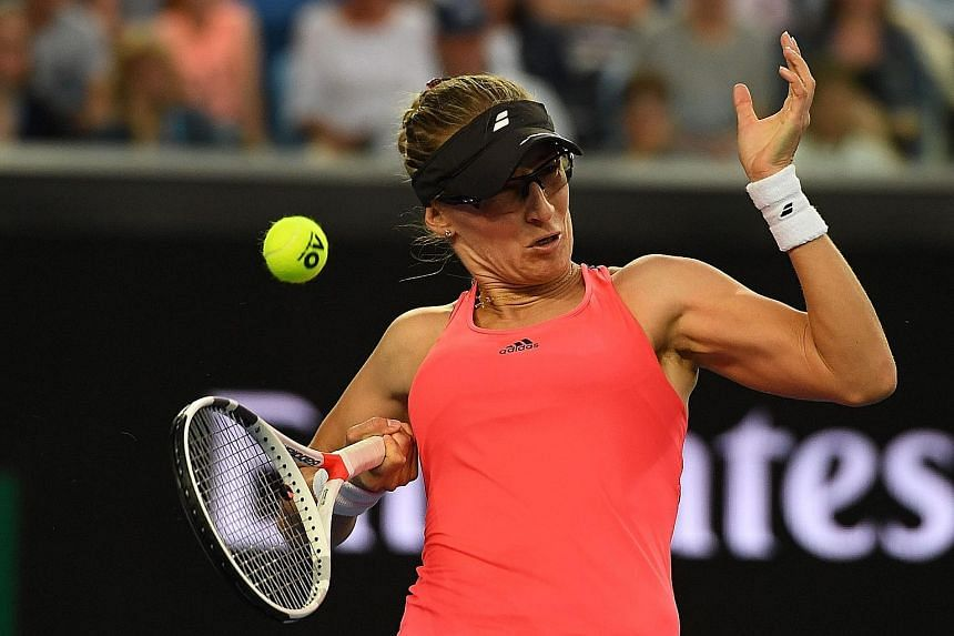 Mirjana Lucic-Baroni of Croatia in action against world No. 3 Agnieszka Radwanska at Margaret Court Arena. She won in straight sets to reach the third round at Melbourne Park for the first time since making her Australian Open debut in 1998.