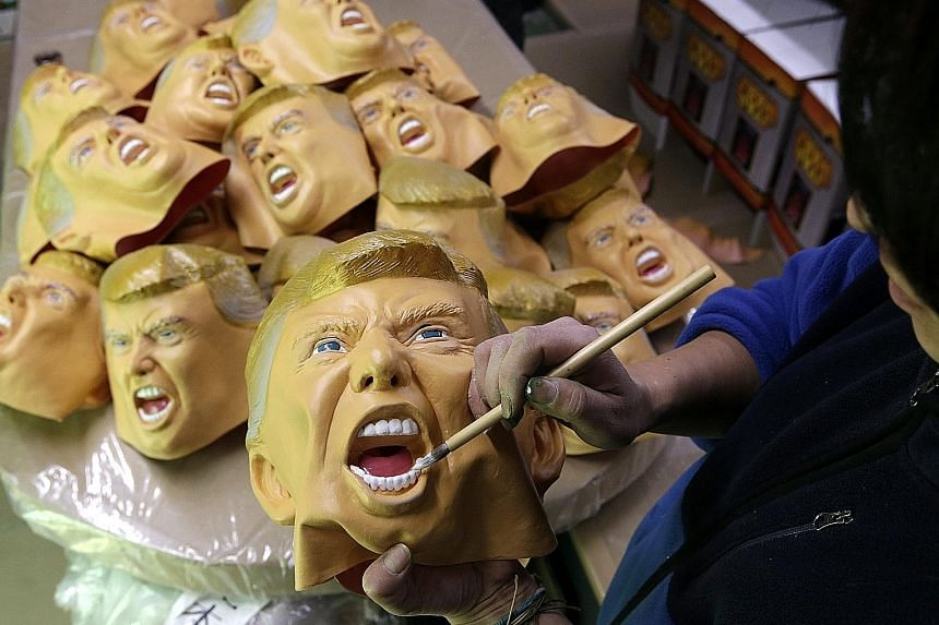 In Saitama, Japan, Ogawa Studio – the only manufacturer of rubber masks in the country – races to fulfil a flood of orders for Trump masks. Ogawa says most customers wear the masks at year-end parties and other social gatherings.